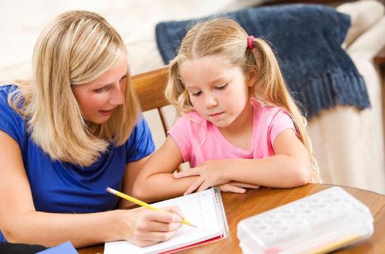 Следует выполнять задание со школьником, но не за него